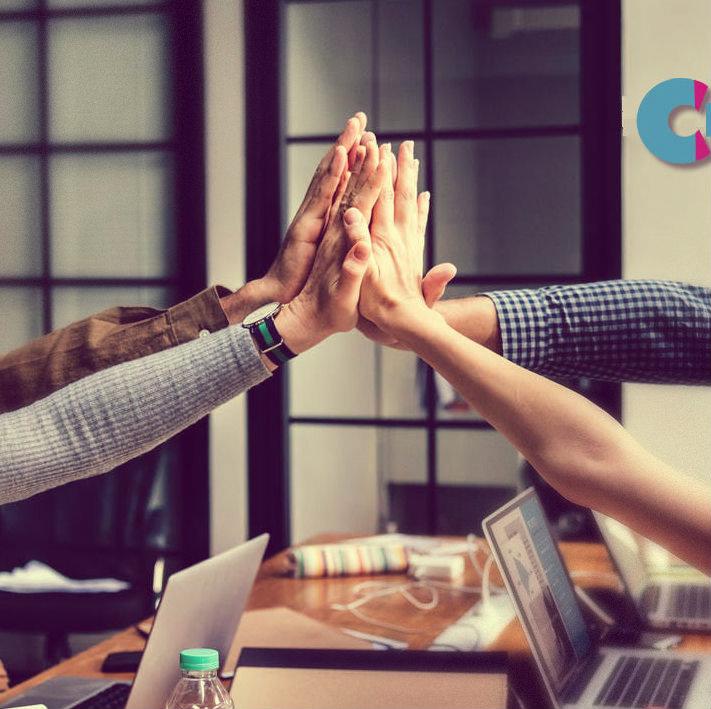 Hands Meeting Over Desk